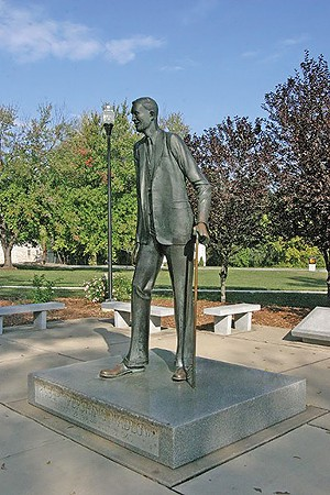 """A life-size statue of Robert Wadlow, the world's tallest person, stands in a park in Alton, his hometown. At 8'11"""", the """"Gentle Giant"""" suffered from an anomaly of his pituitary gland, causing his abnormal growth. He died of an infection at age 22. - PHOTO COURTESY OF THE ALTON REGIONAL CONVENTION AND VISITORS BUREAU"""