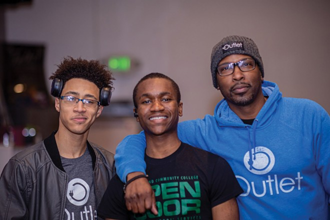 Michael Phelon (far right) with two former Outlet mentees, now mentors for the program themselves. - PHOTO COURTESY MICHAEL PHELON