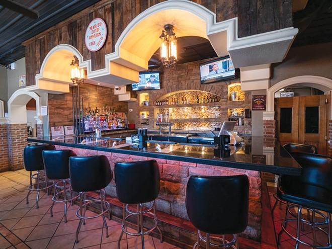 The empty bar at Dew Chilli Pub & Grill on North Grand. - PHOTO BY JOHN LESKOVISEK