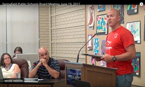 Aaron Graves, in red shirt, at a Springfield school board meeting. - PHOTO BY BRUCE RUSHTON