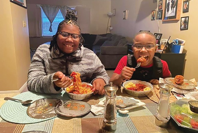 Club Compass participants Annise and Issaac enjoying their spaghetti and meatballs from Copper Pot Cooking Studio as part of Meals that Matter on Jan. 27. - PHOTO COURTESY COMPASS FOR KIDS