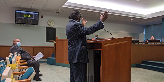 The Rev. Silas Johnson implores the city council to appoint Roy Williams, Jr., left.