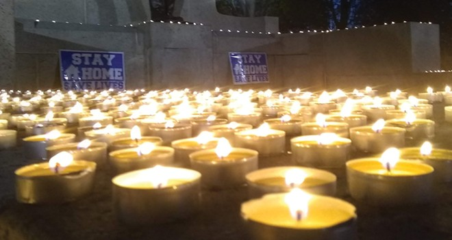 Katharine Eastvold and her friends held a candlelight vigil at the state Capitol - last April for those lost to COVID. At the time, the death toll in Illinois totaled about 2,000. We would need more than 10 times the candles today. - PHOTO COURTESY KATHARINE EASTVOLD
