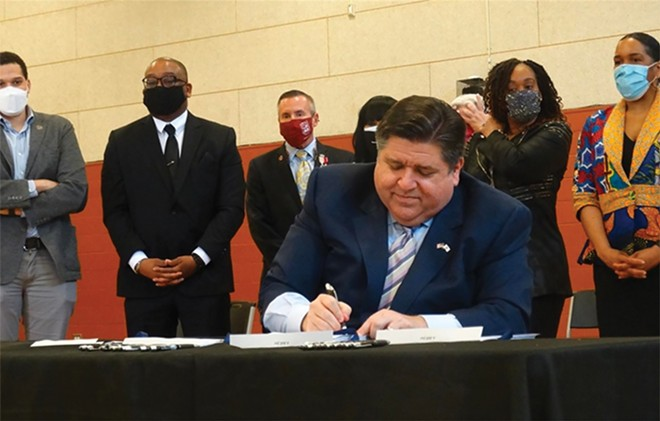 Gov. JB Pritzker is joined by members of the Illinois Legislative Black Caucus and other dignitaries in signing a package of bills aimed at addressing racial economic inequities. - CAPITOL NEWS ILLINOIS PHOTO BY PETER HANCOCK
