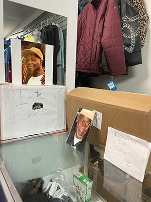 Two donation boxes for the funerals of victims of fentanyl-overdose deaths sit at Brown's store. - CREDIT: MARNELL BROWN