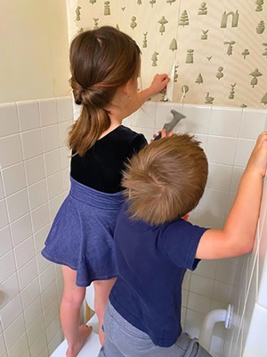 Cecilia, age 6, and Leo, age 3, have enjoyed helping with wallpaper removal. - PHOTO BY LANA SHOVLIN