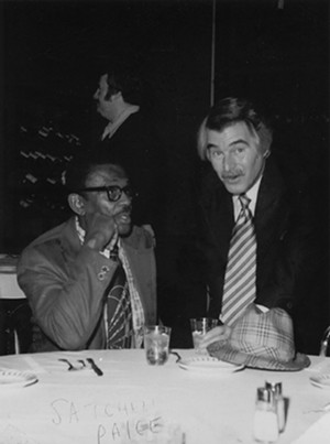 Legendary pitcher Satchel Paige, one of the subjects of the book, worked in Springfield briefly as vice president of the 1978-1982 Springfield Redbirds Triple-A minor league team. Paige is pictured here with Wally Hirstein, the owner of Two Brothers Lounge in Springfield. - CREDIT: SANGAMON VALLEY COLLECTION | LINCOLN LIBRARY