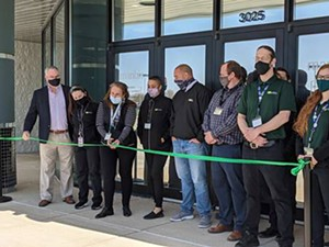 Springfield's latest pot dispensary opened last week with the cutting of a green ribbon. - PHOTO BY BRUCE RUSHTON