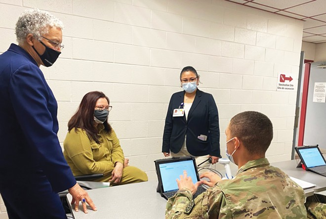 Duckworth visits a Cook County mass vaccination site at Triton College.
