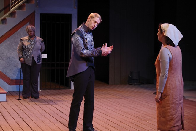 In the final scene of Measure for Measure, Isabella, a young novice to the Order of St. Clare (played - byIsa Guitian, right), challenges the all-powerful Duke of Vienna (Grant Goodman, center) as she seeks - justice for her wrongly imprisoned brother. The noble person Escalus (Lisa Gaye Dixon, left), the Duke's second in command, buttresses Isabella's suit. - PHOTOGRAPHY BY PETE GUITHER