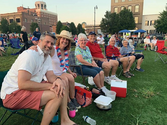 Lisa Clemmons Stott with husband Sean, her parents and her aunt and uncle during a Levitt AMP concert this summer. - COURTESY OF LISA CLEMMONS STOTT