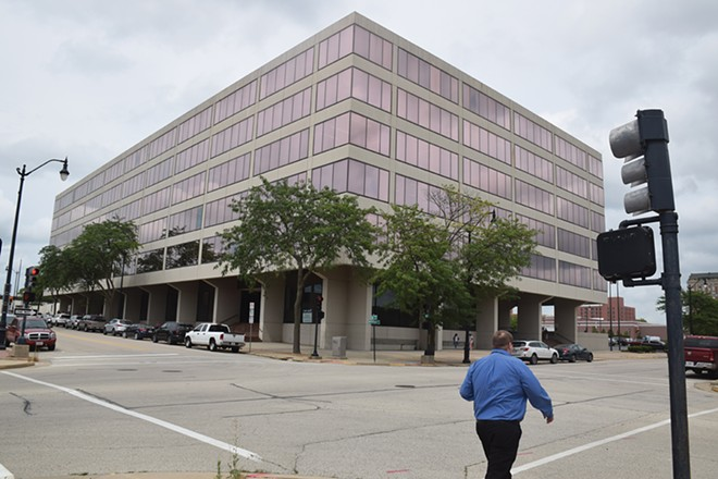 The Alzina building, which provides office space for the Department of Human Services and State Board of Education, is leased for $8 million over five years. - PHOTO BY DAVID BLANCHETTE