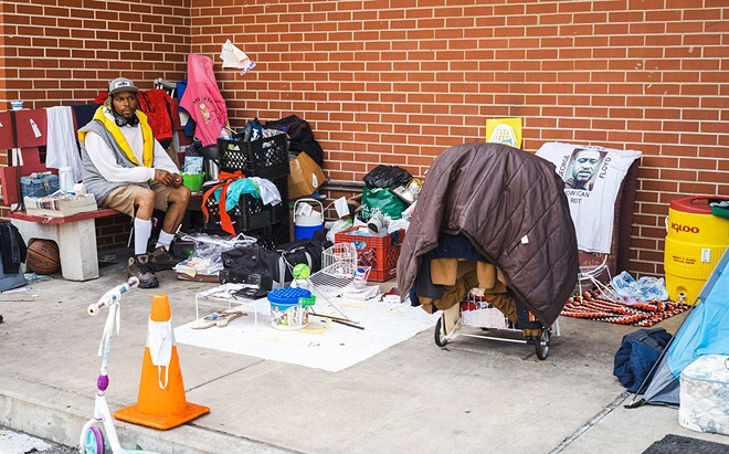 A photo taken in early July of a resident of the tent city that surrounds the former Salvation Army building at 221 N. 11th Street. Planners have proposed the building be used as an overflow shelter. For now, no one is allowed to stay in it overnight. - PHOTO BY ZACH ADAMS, 1221 PHOTOGRAPHY