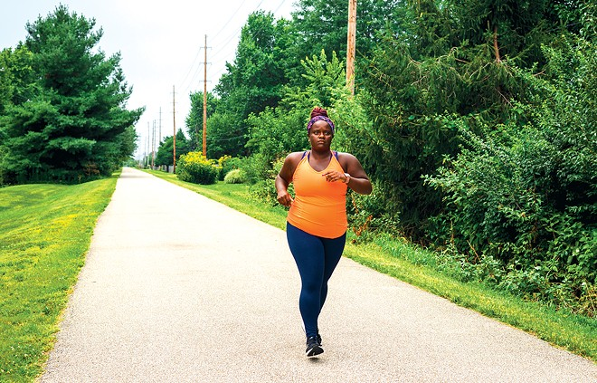 Randall runs on a path near her family home in Springfield during a recent visit to the capital city. - PHOTO BY ZACH ADAMS, 1221 PHOTOGRAPHY.