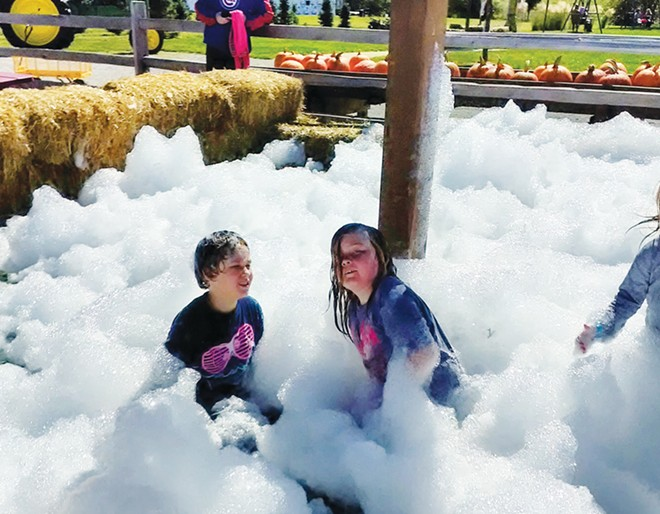 (L-R)  Luca and Kai play in the foam pit at Bomke's Pumpkin Patch. - PHOTO COURTESY OF CAREY SMITH