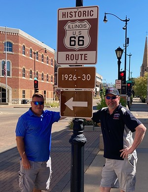 """Greg """"Coop"""" Cooper (left) and Shane """"Shaner"""" McDermith take a stand by a Route 66 designation sign near Sixth and Capitol. - PHOTO BY TOM IRWIN"""