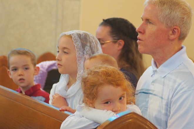 Wes and Beth Clark, of Springfield, attend a Latin Mass with their children Matthew, Joanna, Sara and Jessica. - PHOTO BY SCOTT REEDER