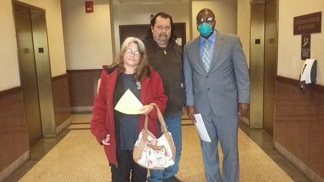 Rick and Carla Phelan with their lawyer Dowin Coffy.