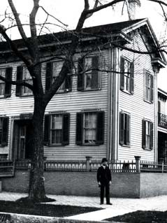 Osborn Hamiline Ingham Oldroyd stands in front of the Lincoln Home, where he lived and operated a Lincoln and Civil War museum between 1883 and 1893. During that time he sold parts of the home and grounds as souvenirs.