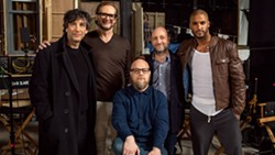 """Bryan Fuller (second from left at top) stands with the cast and crew of """"American Gods."""" The upcoming Starz series is based on a best-selling novel by Neil Gaimon on Fuller's right."""
