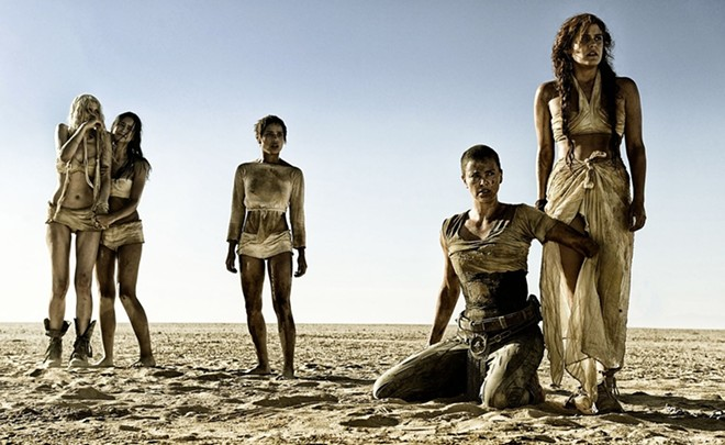 """""""Mad Max: Fury Road"""" was widely hailed as a feminist movie after its release in 2015. In the movie, a harem of five women make a daring escape from slavery led by the warrior Imperator Furiosa, played by Charlize Theron. - WARNER BROS."""