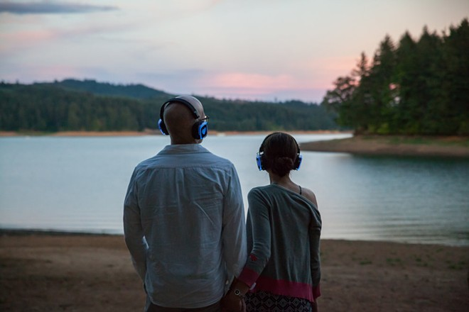 "A couple listen to an ""In a Landscape"" concert via headphones at Henry Hagg Lake in Oregon in 2016. - PHOTO////////"