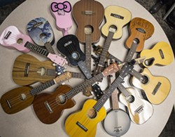 Ukeleles owned by members of the Ukelele Players of the Palouse are gathered together to show the variety of instruments that can be purchased and played during practice Thursday, Jan. 23, 2014, at Simpson United Methodist Church in Pullman. - DEAN HARE