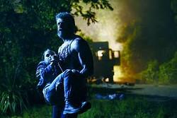 """Hugh Jackman carries Dafne Keen in a scene from """"Logan."""" -- Twentieth Century Fox via AP/Ben Rothstein"""
