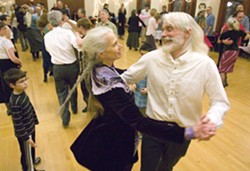 Linda Rasmussen and Bob Johnson dance to the music of Captain Ludd's Rant during a 2012 contra dance at the 1912 Center in Moscow.