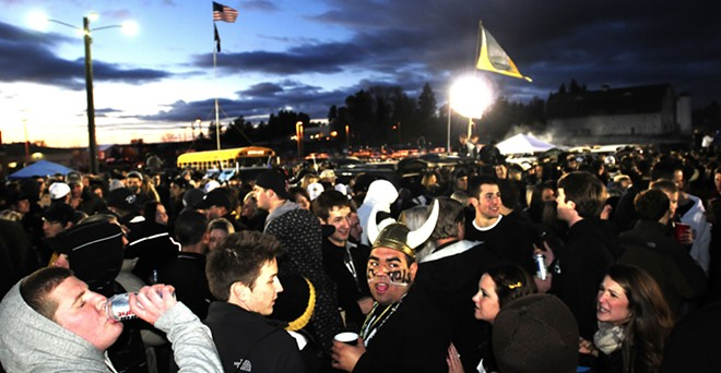 Eager for the kickoff of the Governor's Cup game versus Boise State, Idaho fans pack the west parking lot at the Kibbie Dome for tailgating festivities as dusk settles in on the Palouse on Nov. 12, 2010.