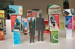 """The Smithsonian exhibit """"Hometown Teams"""" examines how sports shape American life."""