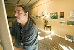 Geoff Crimmins/Daily NewsLarry Arbour works on a painting at Simpson United Methodist Church in Pullman on Thursday.
