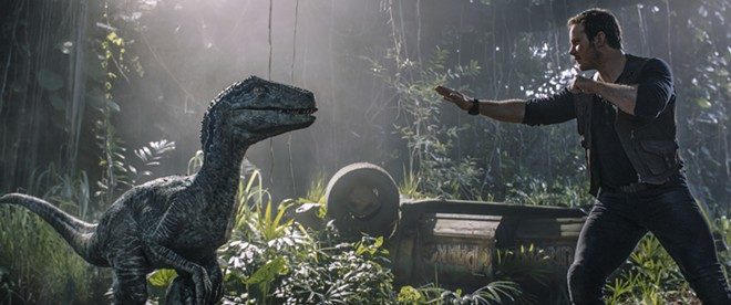 """This image released by Universal Pictures shows Chris Pratt in a scene from, """"Jurassic World: Fallen Kingdom."""" - UNIVERSAL VIA AP"""