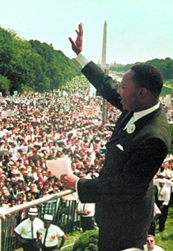 """This Aug. 28, 1963, photo shows Dr. Martin Luther King Jr. acknowledging the crowd at the Lincoln Memorial for his """"I Have a Dream"""" speech during the March on Washington. Monday, Jan. 17, 2011, marks the 25th federal observance of the birth of King, one of America's most celebrated citizens, and the only non-U.S. president to be honored with a national holiday. - AP PHOTO/FILE"""