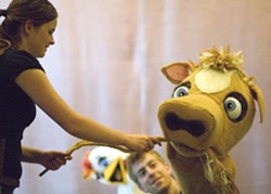 """Geoff Crimmins   Moscow Pullman Daily NewsGus Rose-Witt, left, as Jack, interacts with a cow played by Cory Williamson in the Idaho Repertory Theatre production of """"Jack and the Beanstalk."""" - GEOFF CRIMMINS"""