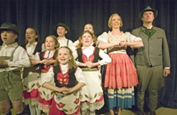 """Geoff Crimmins/Daily NewsTodd Payne as Capt. George Von Trapp, right, and Katie McDougall as Maria Rainer, second from right, sing with the Von Trapp children in a scene from the Regional Theatre of the Palouse's production of """"The Sound of Music."""" - GEOFF CRIMMINS"""
