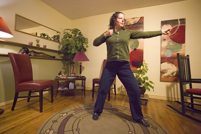 Meggan Baumgartner demonstrates the Eight Treasures qi gong form at Healing Point in Moscow. - PHOTO/GEOFF CRIMMINS