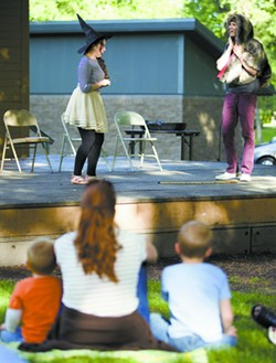 """Families watch the Idaho Repertory Theatre For Youth production of """"The Magic Ink"""" at East City Park in Moscow. - GEOFF CRIMMINS"""