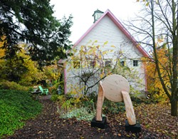 """The Little Pink House Gallery is located behind Vieth's Genesee home. The current exhibit, """"West,"""" includesoutdoor sculpture by Uniontown artist Len Zeoli."""