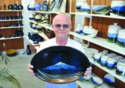 Lewiston artist Michael Wendt has used Mount St. Helens ash for his signature work since 1980 and still has a large supply of the ash. - TRIBUNE/BARRY KOUGH