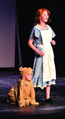 """Maddie Hass sings """"Tomorrow"""" with the help of Charlie Owen as Sandy in Lewiston Civic Theatre's production of """"Annie Jr."""" - TRIBUNE/STEVE HANKS"""
