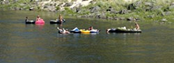 The cool Clearwater River provides a relief from the sweltering heat as a group of people float near Orofino. - TRIBUNE/KYLE MILLS