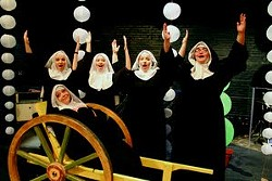 """The cast from """"Nunsense II: The Second Coming: sings """"We're the Nuns to Come to When You Go."""" Lori Wiest, as the Reverend Mother is sitting; standing (from left) are sisters Kristina Gaumnitz, Leticia Monteiro, Katie Berndt and Anya Guadamuz."""