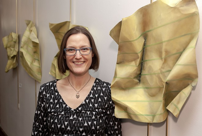Megan Cherry is the new arts program manager for the city of Moscow. Cherry is seen here with pieces from her 'Post-It Apocalyptic' series, on display at the Third Street Gallery in Moscow City Hall. - GEOFF CRIMMINS PHOTO