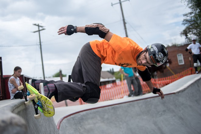 Aaron Flansburg, director of the Palouse Skate Park, does a backside slash grind at the park he started planning 17 years ago. It opens June. 2. - LUKE HOLLISTER