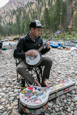 Chris Pandolfi of the Infamous Stringdusters plays the banjo on a trip in 2014.