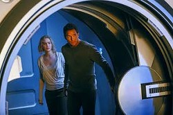 """Jaimie Trueblood/Columbia Pictures/Sony via APIn """"Passengers,"""" Jennifer Lawrence and Chris Pratt play two passengers of a spacecraft traveling to a distant colony planet and transporting thousands of people. But a malfunction in the ship's sleep chambers results in the two being awakened 90 years early."""