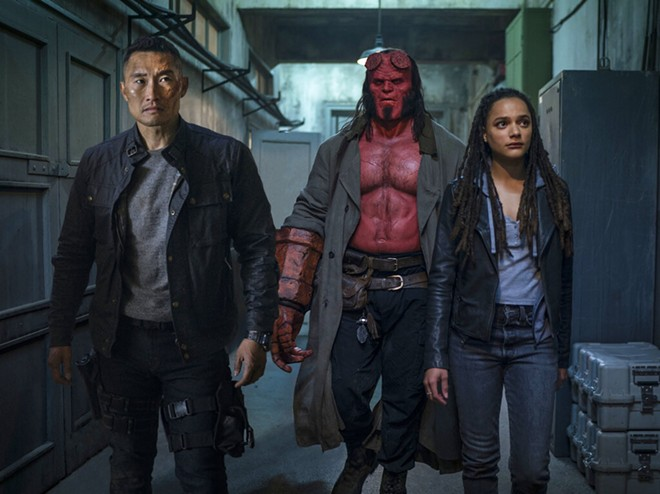 """This image released by Lionsgate shows, from left, Daniel Dae Kim, David Harbour and Sasha Lane in a scene from """"Hellboy."""" - MARK ROGERS/LIONSGATE VIA AP"""