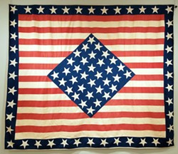 Photo by Joye Dillman -- This 1861 bedcover quilt is in the NSDAR Museum's quilt collection. It is currently on display in the ?A Piece of Her Mind: Culture and Technology in American Quilts? exhibition at the Museum in Washington, D.C.  - JOYE DILLMAN