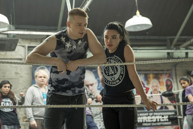 """This image released by Metro Goldwyn Mayer Pictures shows Jack Lowden, left, and Florence Pugh in a scene from """"Fighting with My Family."""" - ROBERT VIGLASKY/METRO GOLDWYN MAYER PICTURES VIA AP"""